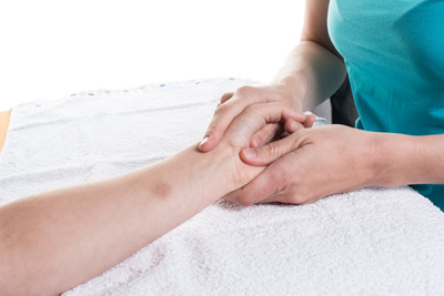person getting a hand massage
